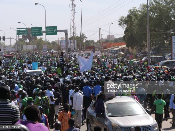 Demonstrators gather during a demonstration asking for former Gambian dictator Yahya Jammeh to come back to Gambia, in Sukuta, Gambia, on January 16,...