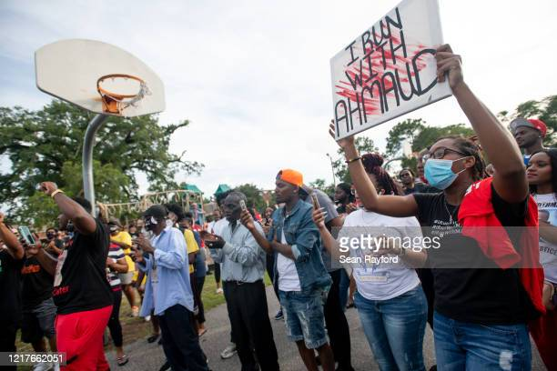 Demonstrators gather during a march after a court appearance by Gregory and Travis McMichael two suspects in the fatal shooting of Ahmaud Arbery on...