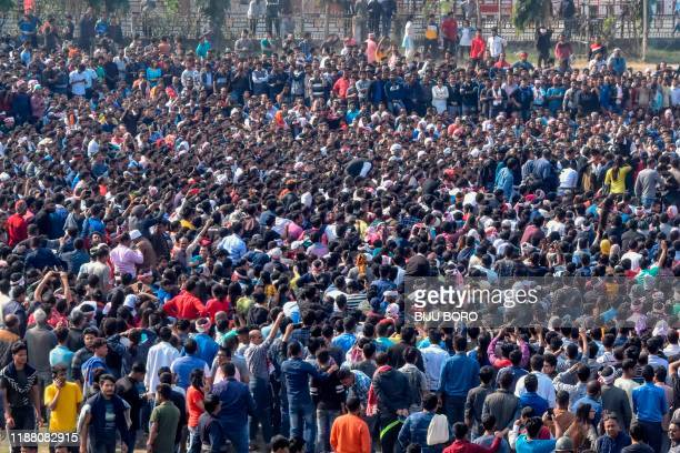 Demonstrators gather during a mass protest against the government's Citizenship Amendment Bill in Guwahati on December 12 2019 Authorities deployed...