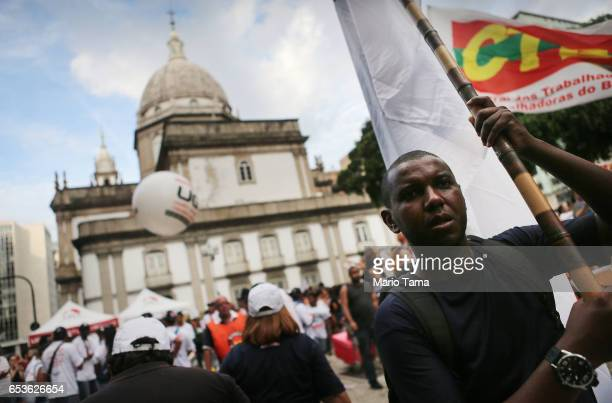 Demonstrators gather during a protest against proposed federal government reforms on March 15 2017 in Rio de Janeiro Brazil Protestors rallied...