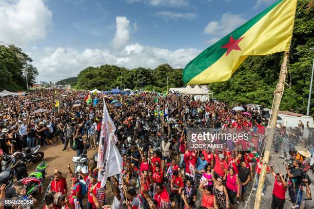 Demonstrators gather during a protest over security and the state of the economy near Kourou space center on April 4 2017 in Kourou French Guiana The...