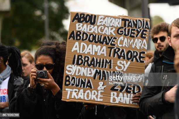 Demonstrators gather during a rally against police violence organized by the Justice for Theo group outside the courthouse of Bobigny near Paris on...