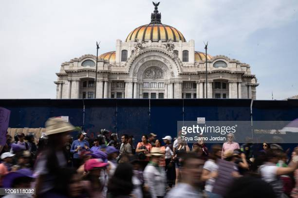 Demonstrators gather during a rally on International Women's Day on March 8 2020 in Mexico City Mexico
