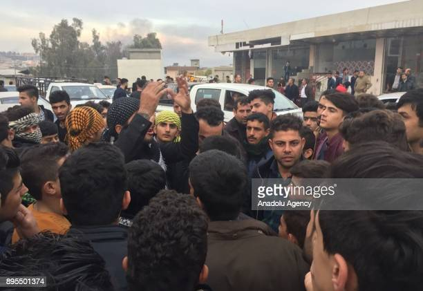 Demonstrators gather during the antigovernment protests in Taktak district of Sulaymaniyah Iraq on December 19 2017