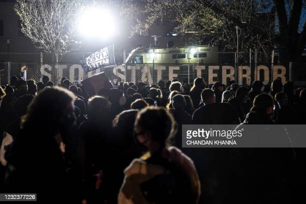 Demonstrators gather during the seventh night of protests over the shooting death of Daunte Wright by a police officer in Brooklyn Center, Minnesota...