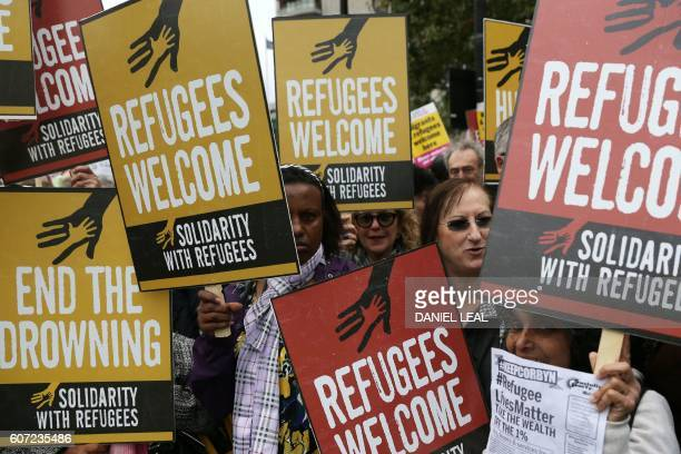 Demonstrators gather for a march calling for the British parliament to welcome refugees in the UK in central London on September 17 2016 Thousands...