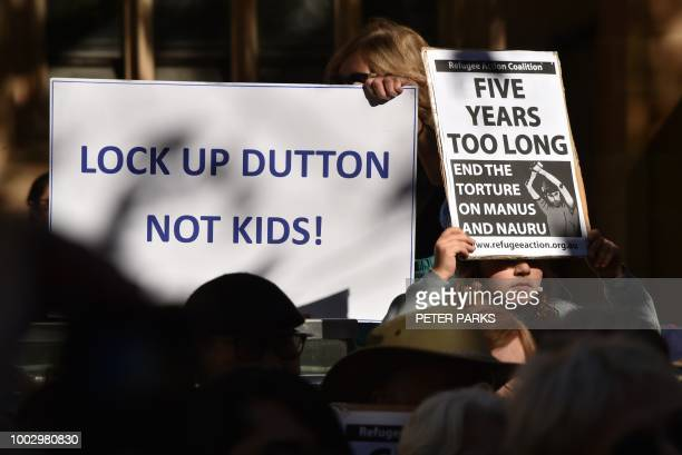 Demonstrators gather for a protest march to demand humane treatment of asylum seekers and refugees in Sydney on July 21 2018 Australia's detention of...