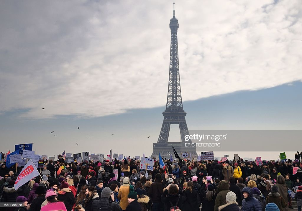 Demonstrators gather for a rally in solidarity with supporters of the Women's March in Washington and many other cities on January 21, 2017 at the Place de Trocadero in Paris, one day after the inauguration of the US President Donald Trump. Protest rallies were held in over 30 countries around the world in solidarity with the Washington Women's March in defense of press freedom, women's and human rights following the official inauguration of Donald J Trump as the 45th President of the United States of America. / AFP / Eric FEFERBERG