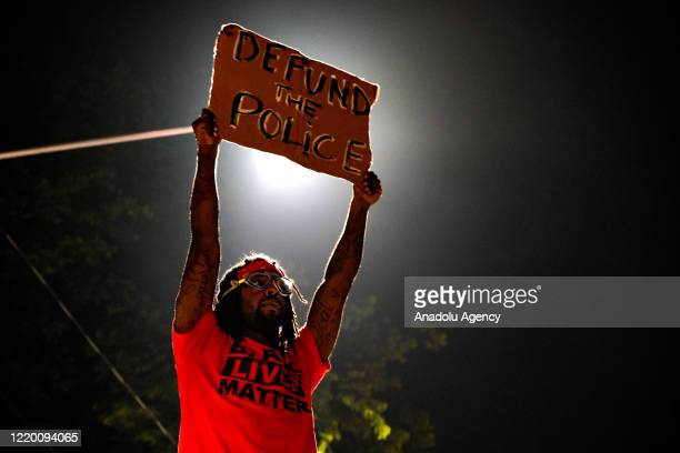 Demonstrators gather for staging a protest after an Atlanta police officer shot and killed Rayshard Brooks at a Wendy's fast food restaurant...