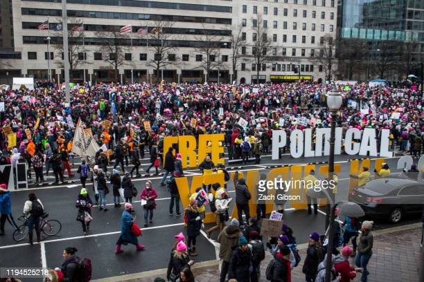 Demonstrators gather in Freedom Plaza at the start of the 2020 Women's March on January 18, 2020 in Washington, DC. Marches were held nationwide in...