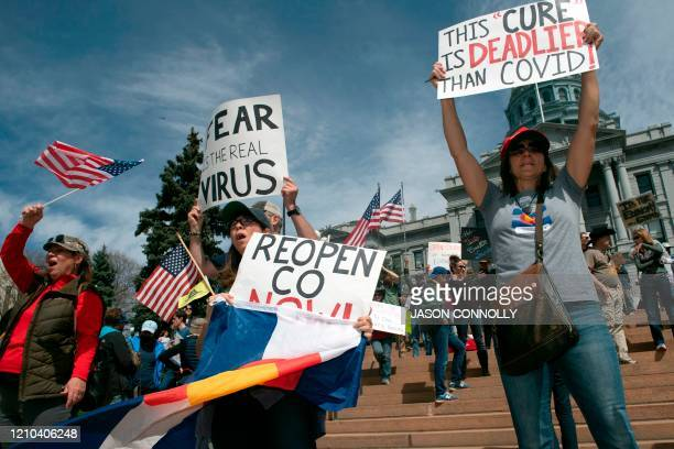 Demonstrators gather in front of the Colorado State Capitol building to protest coronavirus stayathome orders during a ReOpen Colorado rally in...