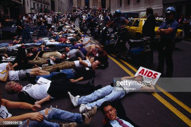 Demonstrators gather in front of the Federal Hall National Memorial in Wall Street in protest of the rising prices of AIDS medication AZT Many hold...