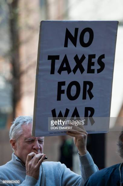 Demonstrators gather in front of the Internal Revenue Service building on April 18 2017 in New York to protest tax dollars being spent on US wars and...