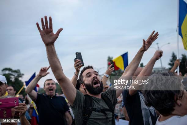 Demonstrators gather in front of the Romanian Prime Minister's office building on June 21 2018 in Bucharest Romania Around 5000 people gathered to...