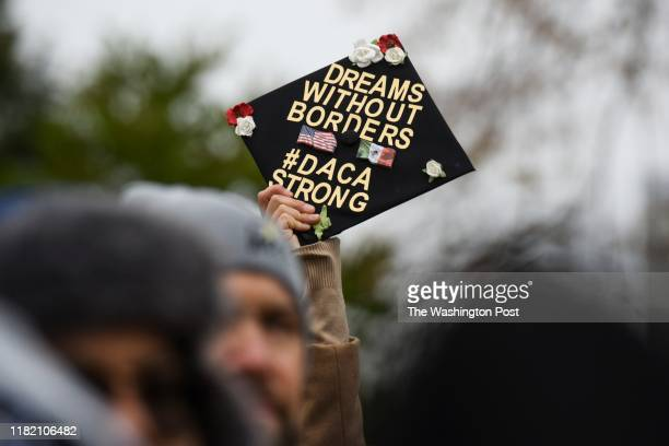 Demonstrators gather in front of the United States Supreme Court, where the Court is hearing arguments on Deferred Action for Childhood Arrivals -...