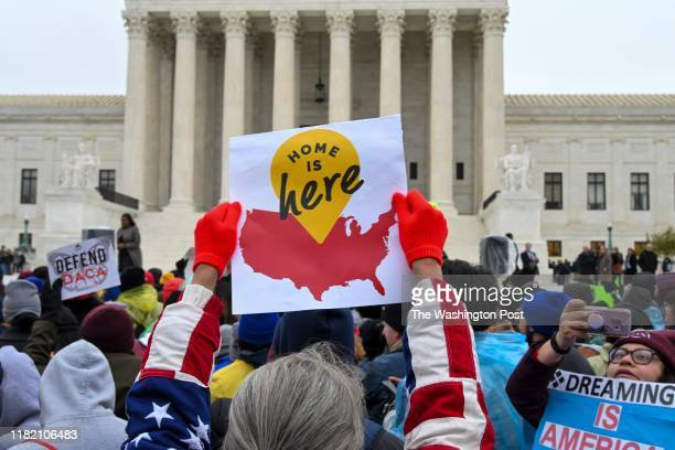 Demonstrators gather in front of the United States Supreme Court where the Court is hearing arguments on Deferred Action for Childhood Arrivals DACA...