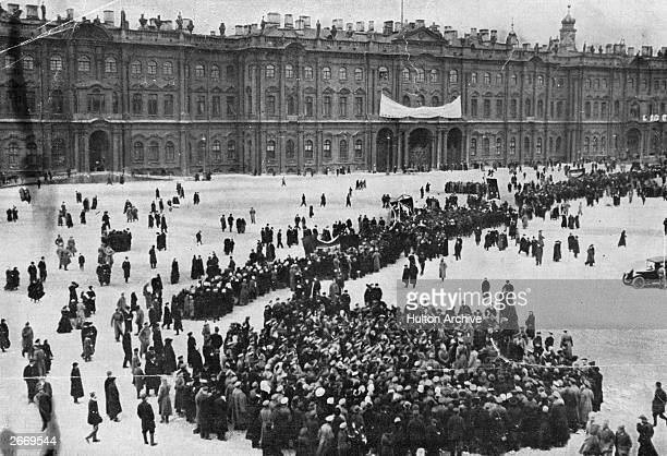 Demonstrators gather in front of the Winter Palace in Petrograd, formerly St Petersburg and later re-named Leningrad, during the Russian Revolution.