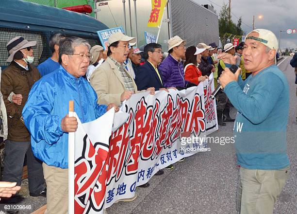 Demonstrators gather in Nago Japan on Jan 5 2017 to protest the US military's resumption of aerial refueling training for Osprey aircraft stationed...
