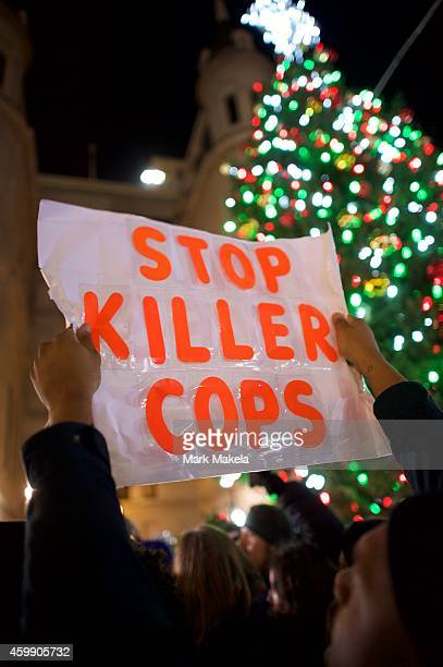 Demonstrators gather in Philadelphia to protest the Eric Garner grand jury decision during a Christmas Tree lighting ceremony at City Hall December 3...