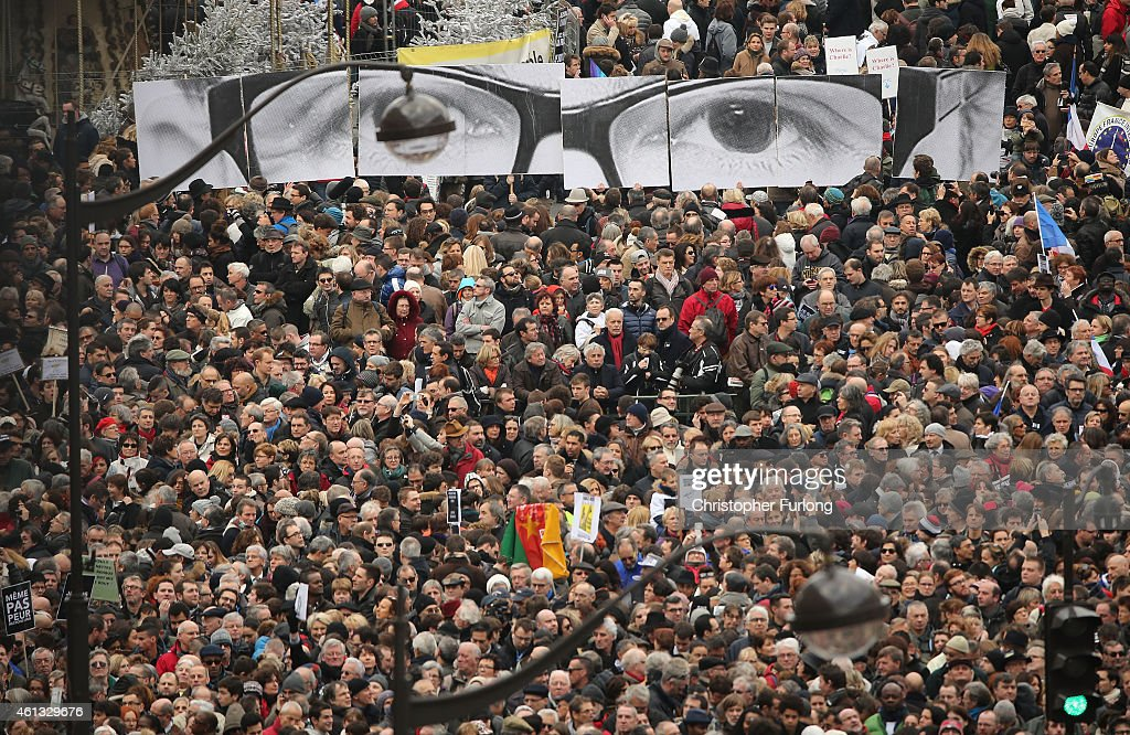Demonstrators gather in Place de la Republique prior to a mass unity rally to be held in Paris following the recent terrorist attacks on January 11, 2015 in Paris, France. An estimated one million people are expected to converge in central Paris for the Unity March joining in solidarity with the 17 victims of this week's terrorist attacks in the country. French President Francois Hollande will lead the march and will be joined by world leaders in a sign of unity. The terrorist atrocities started on Wednesday with the attack on the French satirical magazine Charlie Hebdo, killing 12, and ended on Friday with sieges at a printing company in Dammartin en Goele and a Kosher supermarket in Paris with four hostages and three suspects being killed. A fourth suspect, Hayat Boumeddiene, 26, escaped and is wanted in connection with the murder of a policewoman.