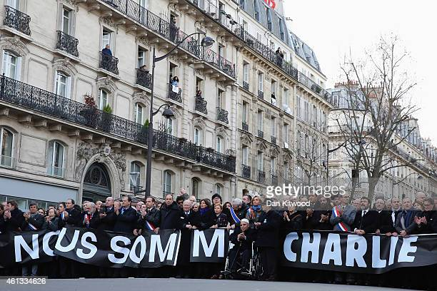 Demonstrators gather in Place de la Republique prior to a mass unity rally to be held in Paris following the recent terrorist attacks on January 11...
