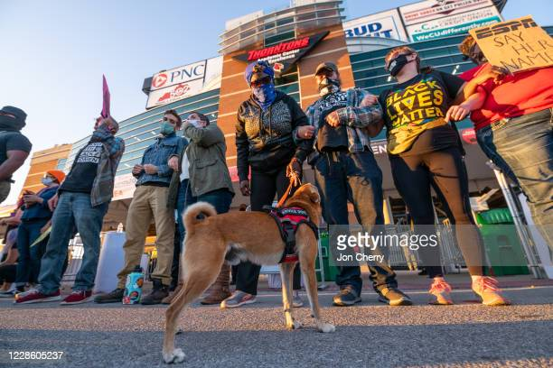 Demonstrators gather in protest outside Cardinal Stadium during a game between the Miami Hurricanes and the Louisville Cardinals on September 19,...