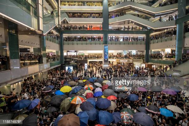 Demonstrators gather in the atrium of the New Town Plaza shopping mall operated by Sun Hung Kai Properties Ltd during a protest in the Shatin...