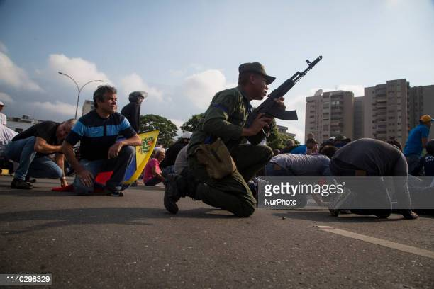 Demonstrators gather near La Carlota air force on April 30 2019 in Caracas Venezuela Through a live broadcast via social media Venezuelan opposition...