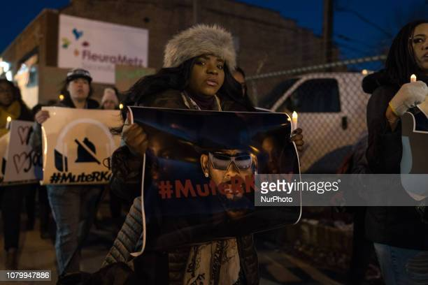 Demonstrators gather near RampB singer R Kellys former recording studio in Chicago on January 9 2019 following the release of a Lifetime docuseries...