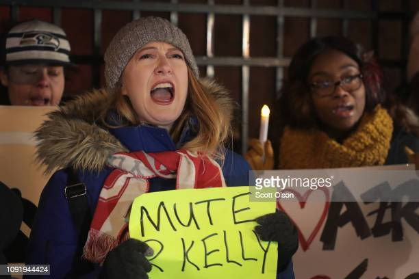 Demonstrators gather near the studio of singer R Kelly to call for a boycott of his music after allegations of sexual abuse against young girls were...