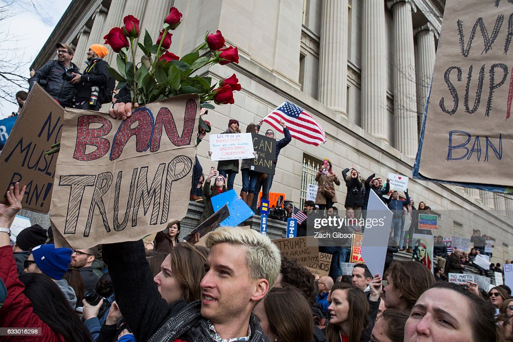 Demonstrators gather near The White House to protest President Donald Trump's travel ban on seven Muslim countries on January 29, 2017 in Washington, DC. President Trump signed the controversial executive order that halted refugees and residents from predominantly Muslim countries from entering the United States.