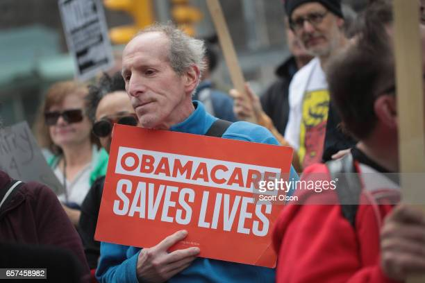 Demonstrators gather near Trump Tower to celebrate the defeat of President Donald Trump's revision of the Affordable Care Act on March 24, 2017 in...
