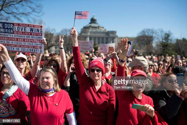 Demonstrators gather of the east lawn of the Capitol for a rally with House Minority Leader Nancy Pelosi DCalif and other Democratic members after...