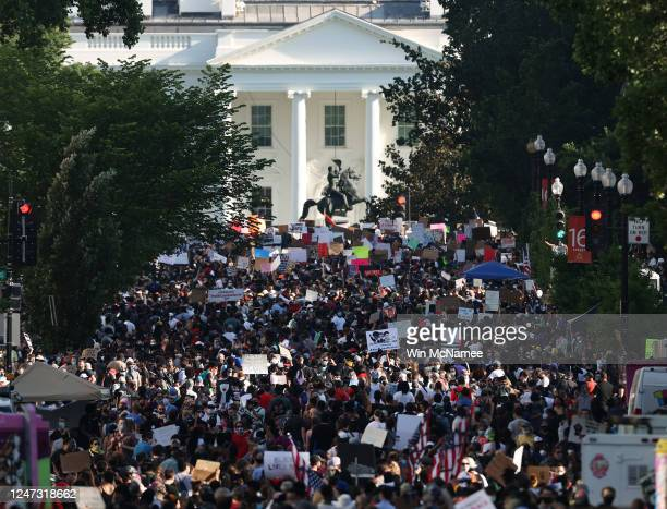 Demonstrators gather on 16th Street and the portion newly named Black Lives Plaza across from Lafayette Park while protesting peacefully against...