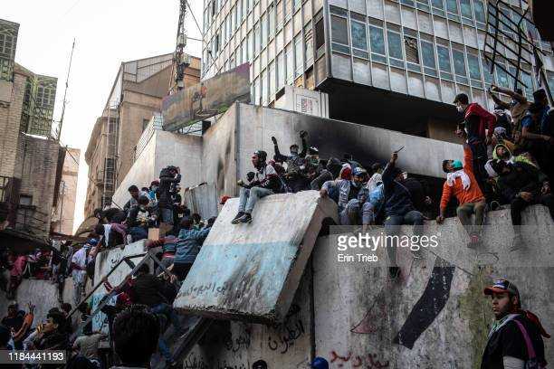 Demonstrators gather on a barricade near Ahrar Bridge where there have been recent clashes between demonstrators and Iraq security forces on November...