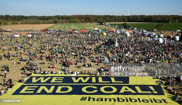 Demonstrators gather on October 6 2018 close to the Hambacher Forst forest near Buir and Niederzier western Germany in a protest to stop the ancient...