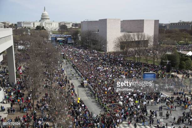 Demonstrators gather on Pennsylvania Avenue as the US Capitol building stands in the background during the March For Our Lives in Washington DC US on...