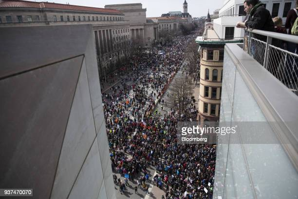 Demonstrators gather on Pennsylvania Avenue during the March For Our Lives in Washington DC US on Saturday March 24 2018 Thousands of high school...