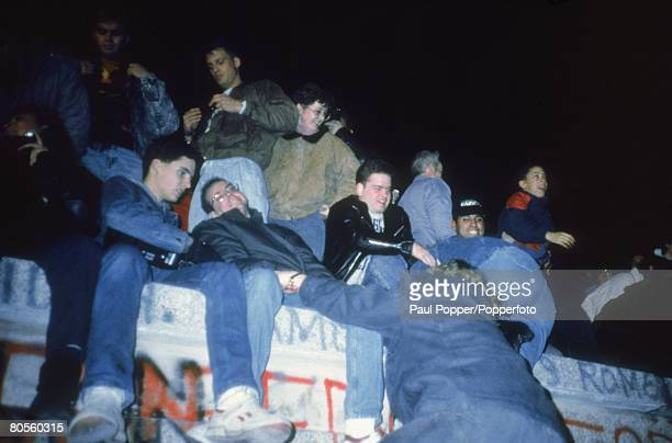 Demonstrators gather on the Berlin Wall on the night of 10th/11th November 1989 A day earlier the East German Propaganda Minister had announced that...
