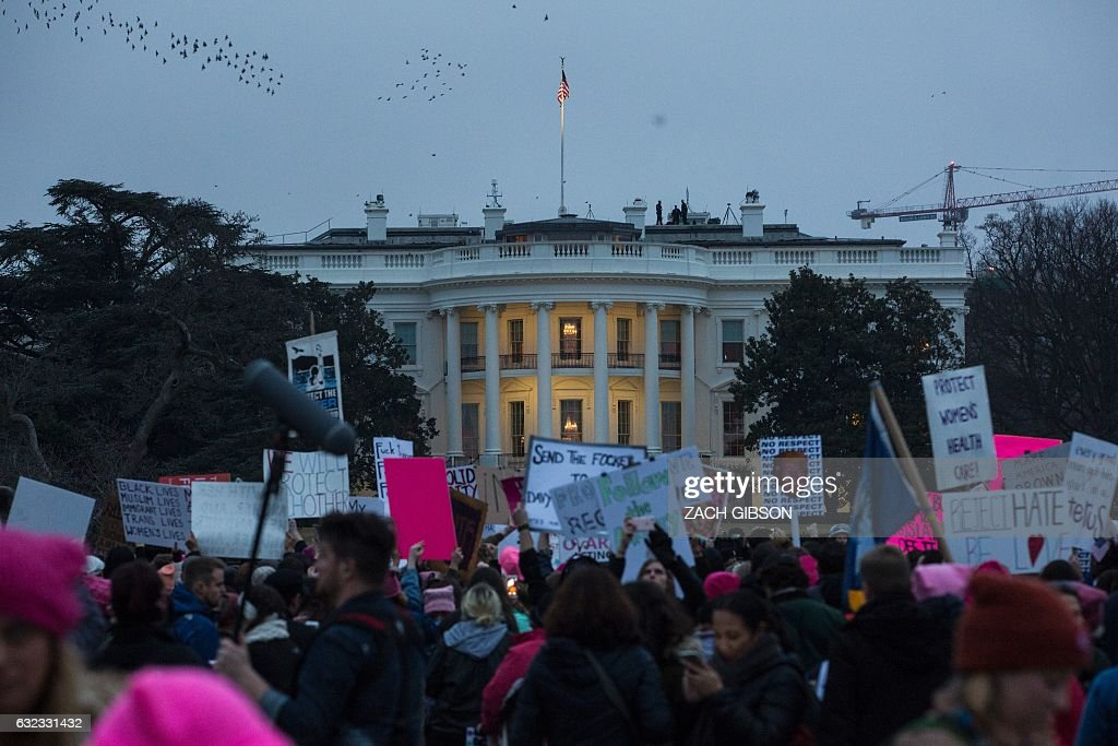 TOPSHOT - Demonstrators gather on The Ellipse during the Women's March on Washington January 21, 2017 in Washington, DC. Hundreds of thousands of protesters spearheaded by women's rights groups demonstrated across the US to send a defiant message to US President Donald Trump. / AFP / ZACH