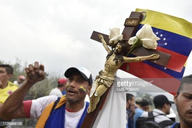 TOPSHOT Demonstrators gather on the Simon Bolivar international bridge in Cucuta Colombia after President Nicolas Maduro's government ordered to...