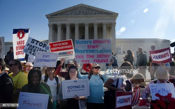 Demonstrators gather outside of The United States Supreme Court during an oral arguments in Gill v. Whitford to call for an end to partisan...
