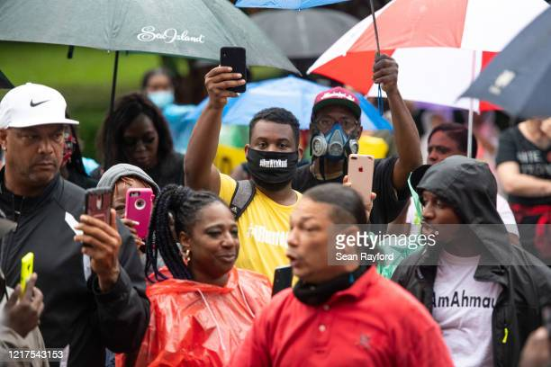 Demonstrators gather outside the Glynn County Courthouse where Gregory and Travis McMichael attended a preliminary hearing on June 4 2020 in...