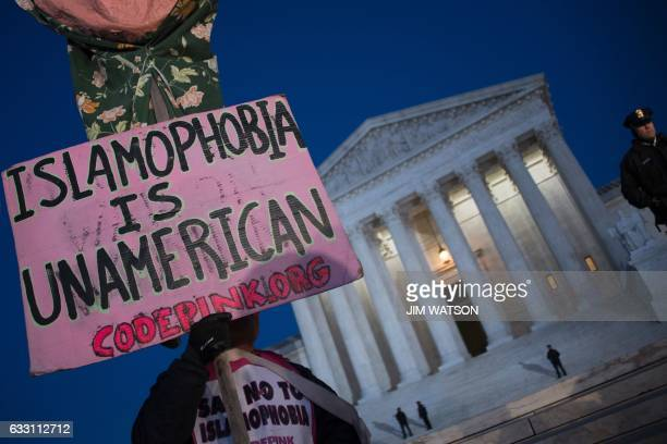 TOPSHOT Demonstrators gather outside the US Supreme Court demanding US President Donald Trump reverse hateful antirefugee and antiimmigration...