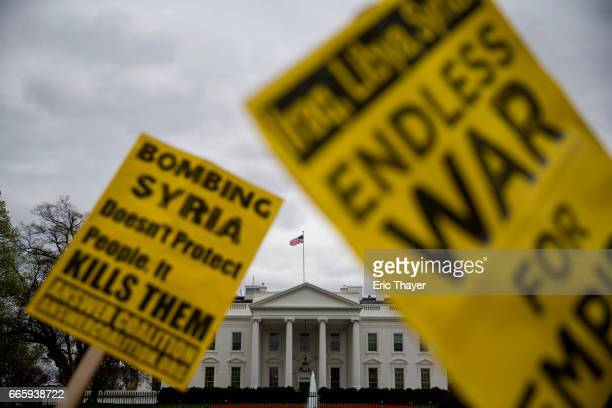 Demonstrators gather outside the White House to protest the recent US missile strike in Syria April 7 2017 in Washington DC The United States has...