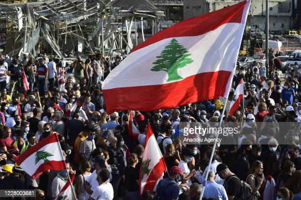 Demonstrators gather to march towards the parliament building following the resignation of Lebanese government, during the fourth day of the...