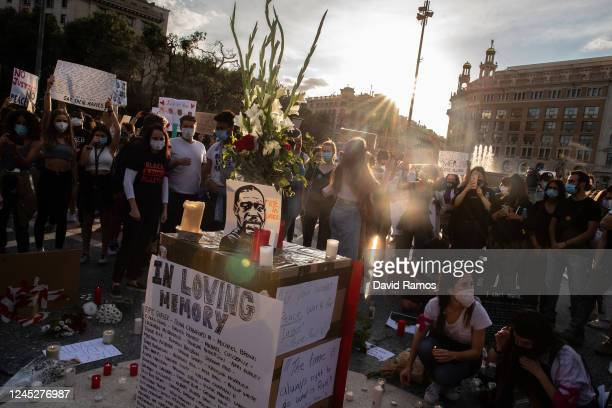 Demonstrators gather to mourn the death of George Floyd during a vigil at Catalunya Square on June 04, 2020 in Barcelona, Spain.The death of an...