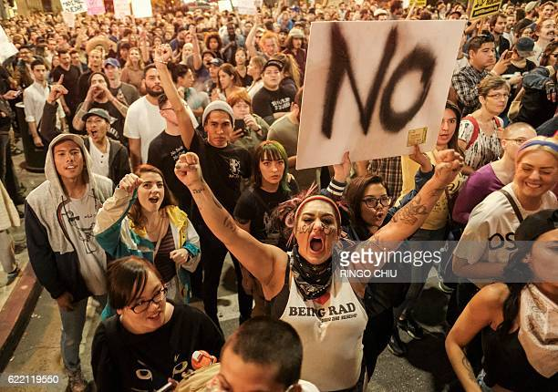 TOPSHOT Demonstrators gather to protest a day after Presidentelect Donald Trump's victory at a rally outside Los Angeles City Hall in Los Angeles...