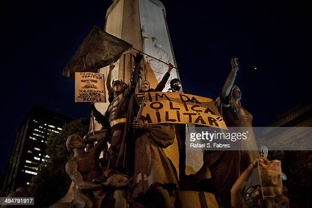 Demonstrators gather to protest against the corruption and the price hikes in Cinelandia on May 30 2014 at the centre of Rio de Janeiro Brazil...