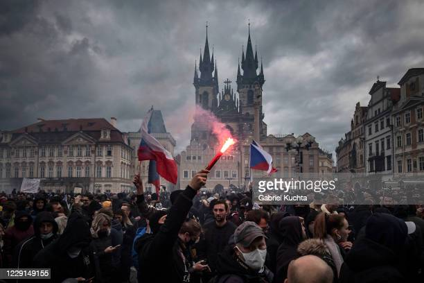 Demonstrators gather to protest against the COVID-19 restrictive measures at Old Town Square on October 18, 2020 in Prague, Czech Republic. The Czech...